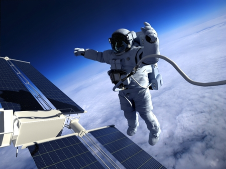 astronaut: Astronaut in space around the solar battarei.Elemen ts of this image furnished by NASA