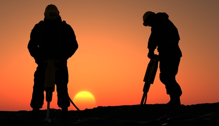 Silhouette of a worker at sunset. photo