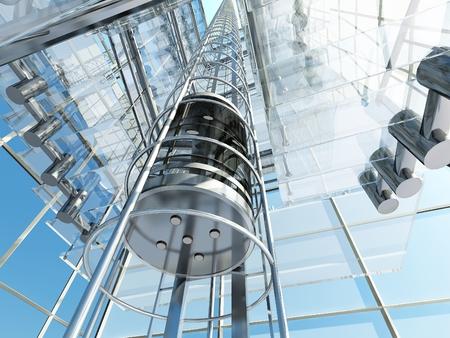 유리 건물에 엘리베이터.