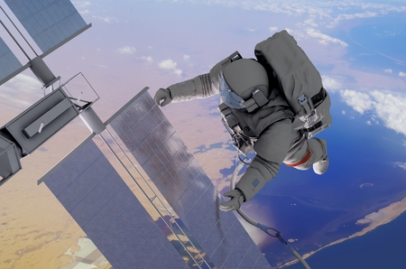 Astronaut working in space above the planet. photo