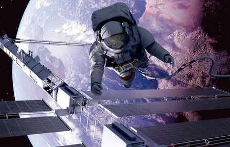 NASA: Astronaut in space around the solar battarei.Elemen ts of this image furnished by NASA