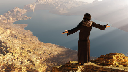 Priest piously on the mountain. photo