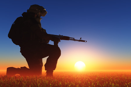 Silhouette of a soldier against the sun. photo