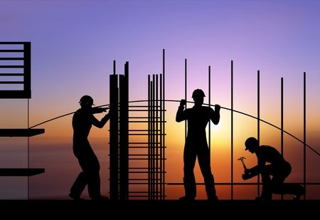 Silhouette of the workers on a background of the sky Banque d'images