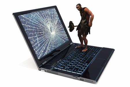 Primitive man on the laptop. photo