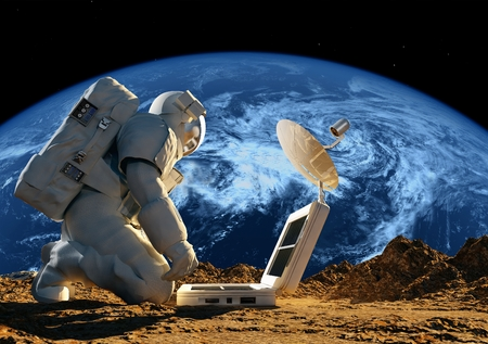Astronaut on his knees near the solar battery. Elemen ts of this image furnished by NASA