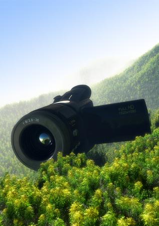 glasses eye: The digital camera on a green landscape.