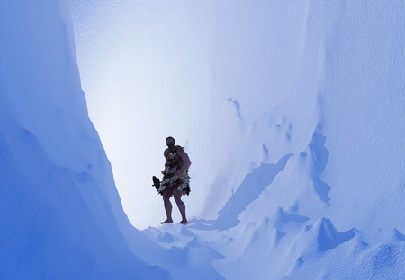 nude male: Primitive man in the ice cave.