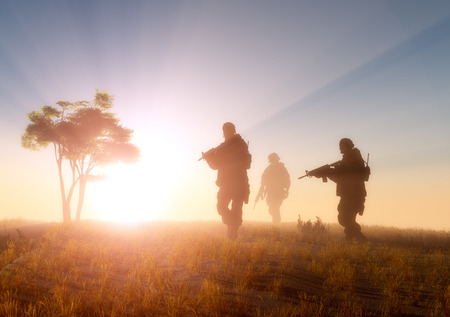 sundown: Silhouette of a group of soldiers at sundown.