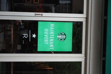 Montreal, Quebec / Canada - June 09, 2020: Starbucks that we are open.