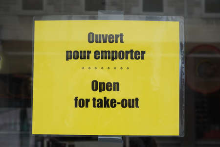 Montreal, Quebec / Canada - June 09, 2020: Takeout sign in French and English. Redakční