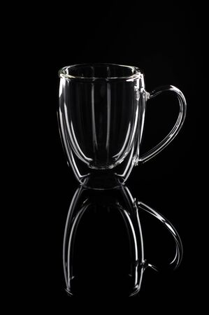 glass cup with thick glass on a black background.
