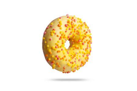 yellow glazed donut with colored splashes. isolated on white background.