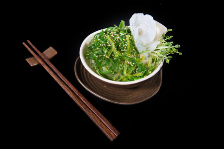 sake maki: Japanese salad with chopsticks