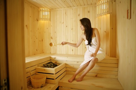 steam room: woman in a spa and beauty steam room