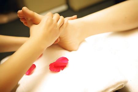 human foot: Foot Massage hand foot relax spa closed Stock Photo