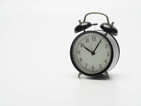 Black alarm clock isolated on white background. Space for text Foto de archivo