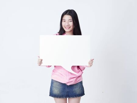 Portrait of teenage girl showing placard empty isolated on white background. Archivio Fotografico