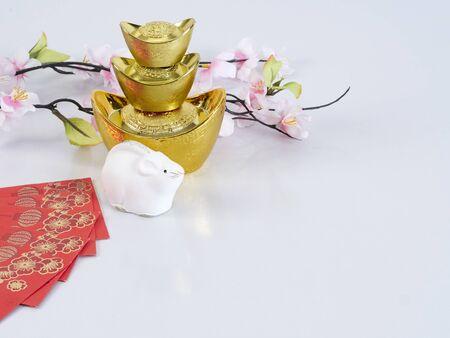 Happy chinese new year or lunar new year. Dolls of mouse, chinese gold ingot and flowers of good fortune on white background. (English translation for foreign text means blessing, luck and wealthy).