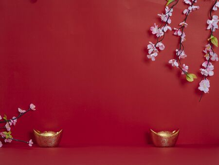 Chinese new year 2020. Happy chinese new year or lunar new year. Flowers of good fortune and lump of gold on red background (English translation for foreign text means blessing, luck and wealthy). Standard-Bild