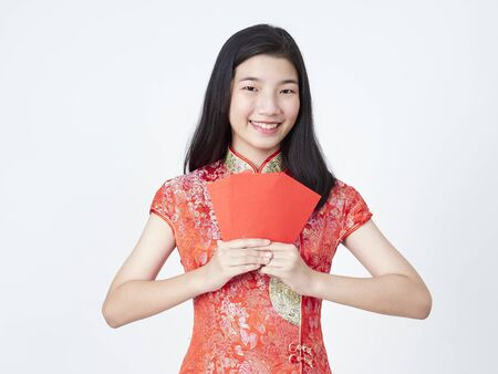 Portrait of asian woman in traditional chinese dress holding red envelope isolated on white background. Chinese new year. Concept New Year Sale.