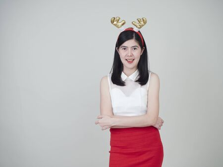 Portrait of beautiful woman asian girl and happy in costume celebrate christmas on white background.