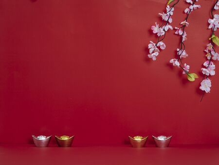 Chinese new year 2020. Happy chinese new year or lunar new year. Flowers of good fortune and lump of gold on red background (English translation for foreign text means blessing, luck and wealthy).