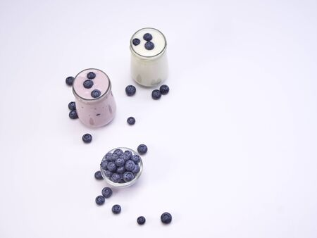 Healthy fresh blueberry yogurt isolated on a white background. Fruit vitamins for health. space for text, top view