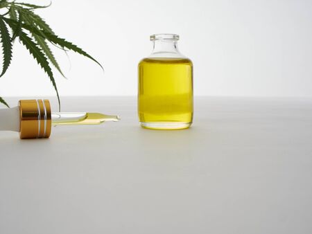 Medicinal cannabis with extract oil in a bottle on white background, Healthcare concept, Empty space for design. CBD hemp oil.