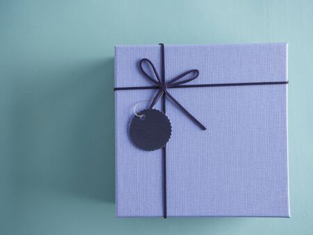 Close-up of gifts box on light blue background. Top view, copy space for mock up.