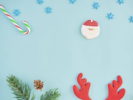 Close-up of christmas decorations against light blue background.