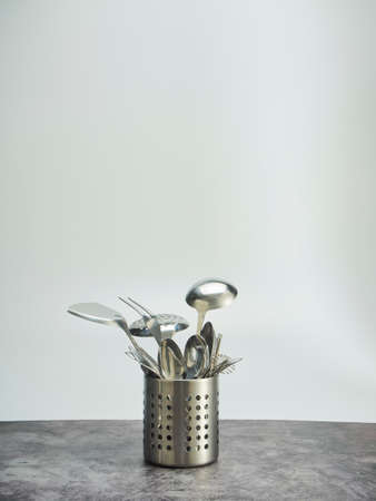 Cutlery holder, stainless steel on table against the white background