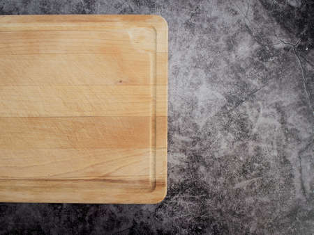 Cutting board wood on grey marble table. Top view Reklamní fotografie