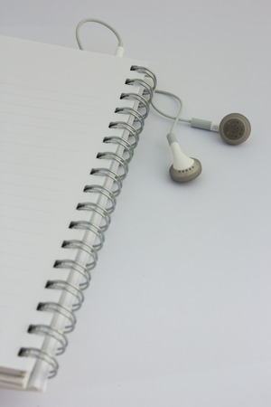 earphone: notebook with earphone for musics Stock Photo