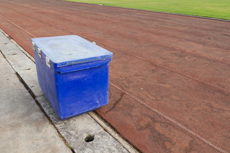 big blue ice bucket on the running track