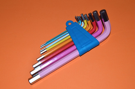 Colorful Hex Keys on the table as background
