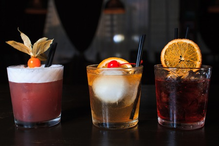 sweet vermouth: three alcoholic drink on the table in the club