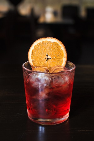 sweet vermouth: cool alcoholic cocktail on the table with oranges Stock Photo