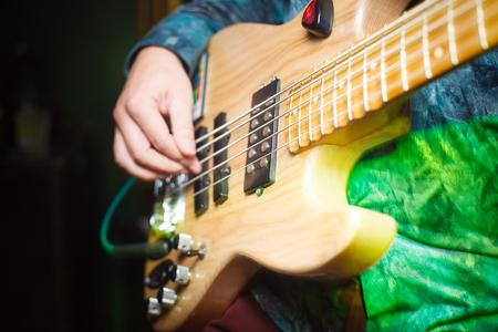 Guitarist plays electric guitar beautiful closeup
