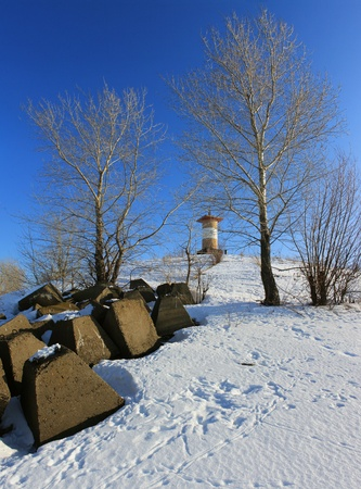 strengthening: Winter landscape with a lighthouse on the shore    Stock Photo