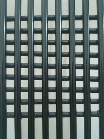 grid: Black metal grill on white background