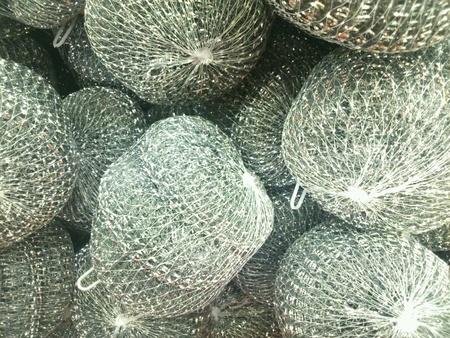 metallic: Closeup of metallic dish washing loofah