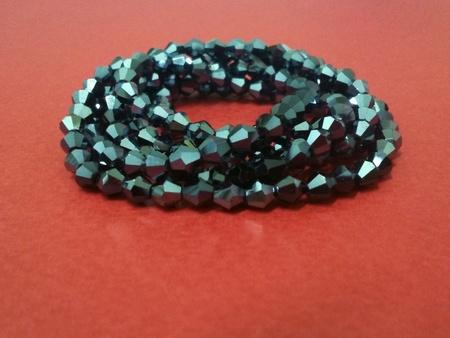 shiny: Shiny beaded necklaces on red background Stock Photo