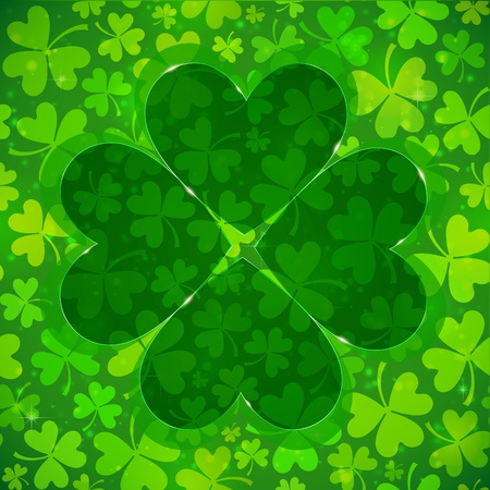 Green four-leaf clover shape on light clovers background photo