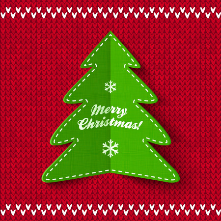 Green Christmas tree applique on red knitted background Vector