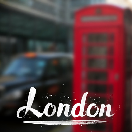telephone box: London calligraphy sign on blurred photo background
