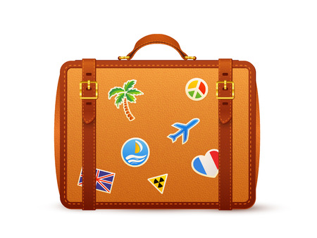 travelers: Orange leather suitcase with travelers stickers