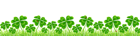 Green four-leaf clovers field Stock Photo