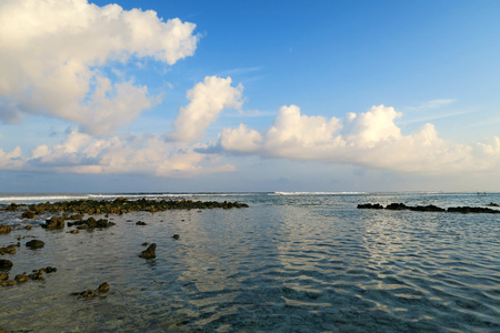 jailbreak: Local surfing spot on Himmafushi island, Maldives: clouds reflection in ocean Stock Photo