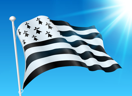 Breton flag on wind with sunshine and blue sky.